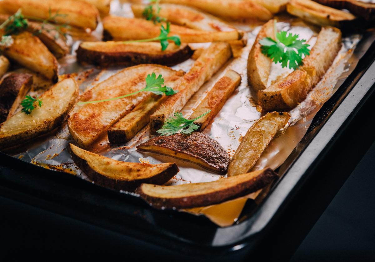 Sweet potato and potato wedges with cumin and dry mango powder.